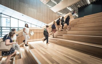 Decorative image of students walking up stairs