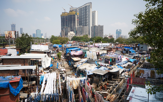 Rows of open-air laundry stalls known as Dhobi Ghat