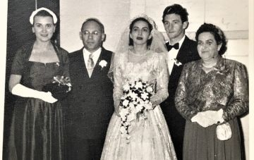 At the wedding of Sam Susskind, one of the Buchenwald group. Leo and MIna were 'unterfirers' representing Sam's late parents.