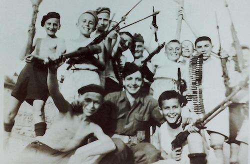 Boys entertaining themselves in the quarry in Buchenwald post liberation – Melbourne Boys Sam M (back left) and Benjamin G (back right)