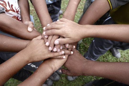 Indigenous hands symbolising community