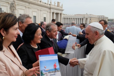 The Pope receiving a report on osteoporosis in men produced by Professor Peter Ebeling from the CEO and President of the International Osteoporosis Foundation