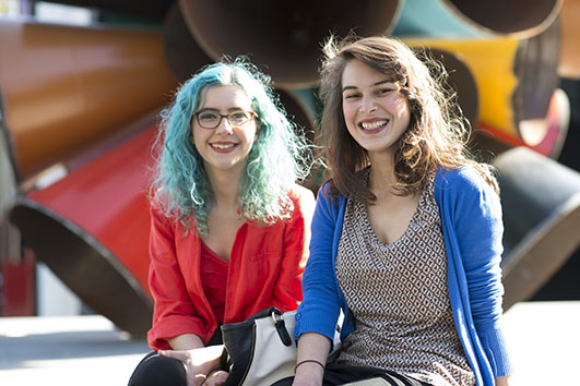 Two Monash Extension students smiling