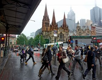 Pedestrians outside Flinders Street Station and St Paul's Cathedral, Melbourne
