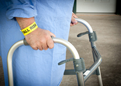 Older person with a walker and a fall risk bracelet