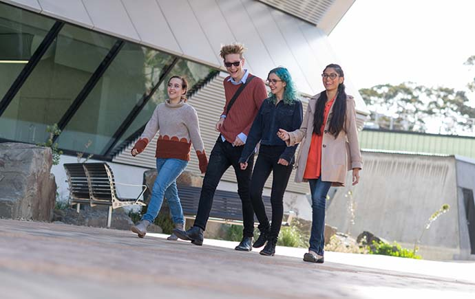 Students in a line laughing and walking