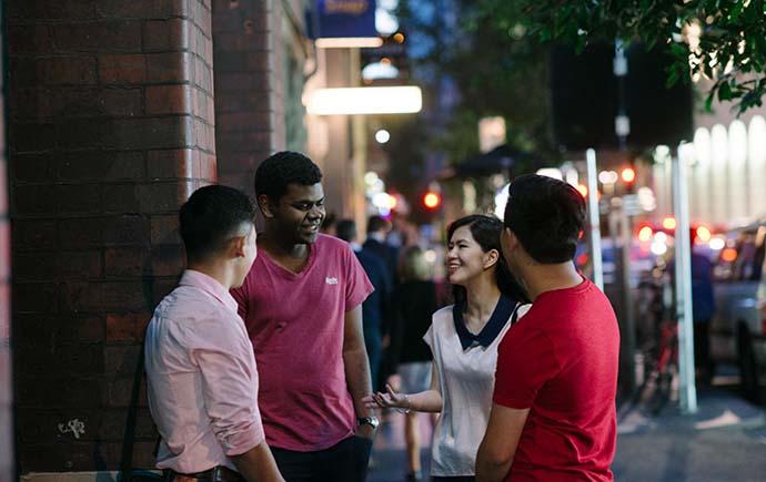 Group of students huddled outside