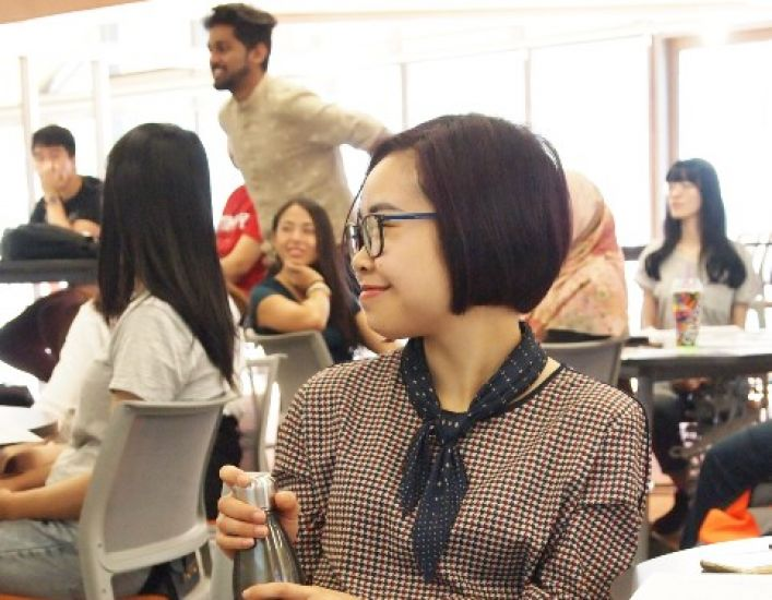 Female student smiling while listening