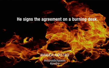 He signs the agreement on a burning desk.