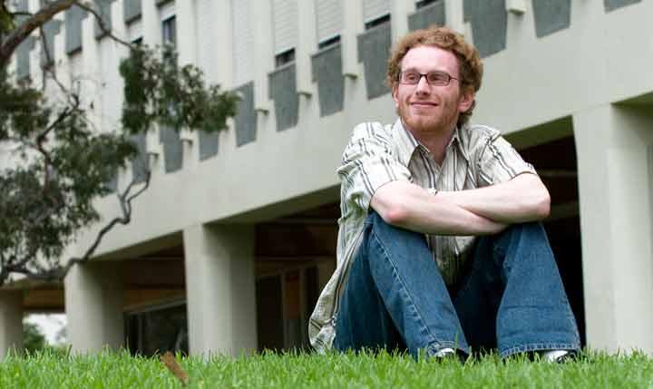 student sitting on grass