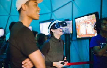 Student smiling while playing virtual reality game