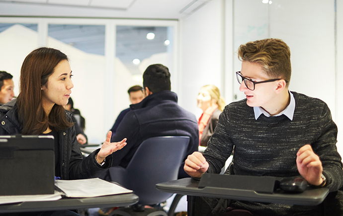 Man Chatting to Woman During Workshop