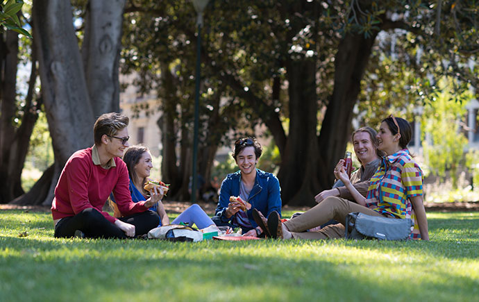 Students eating lunch on the grass