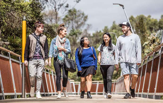 Students walking on bridge