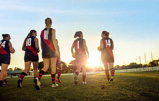 Women playing AFL football