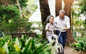 Grandparent and grandchild playing with bike