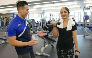 Instructor guide gym user through weight training
