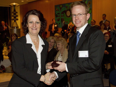 The Hon Louise Asher MP, Minister for Innovation, congratulates Dr Chris McNeill