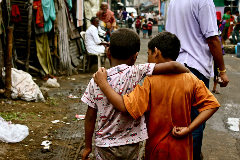 Two little boys walking arm-in-arm, Kolkata, India