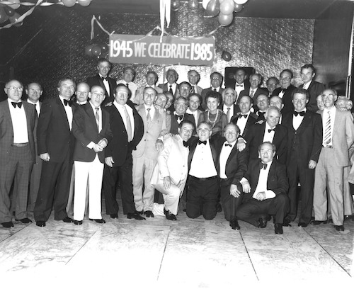 Mina Fink, affectionately called the Mother of the Buchenwald Boys, surrounded by the Boys at 40th Anniversary Ball