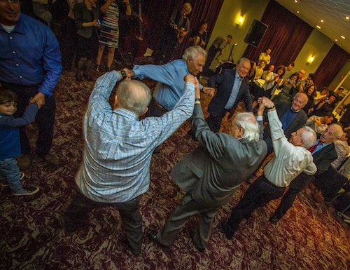 The Boys dancing at the 70th anniversary of their liberation, with second and third generations looking on, 2015. Courtesy Andrew Harris.