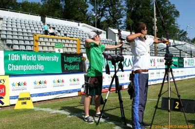 Alec with an archer from Belarus on the practice range in Legnica.