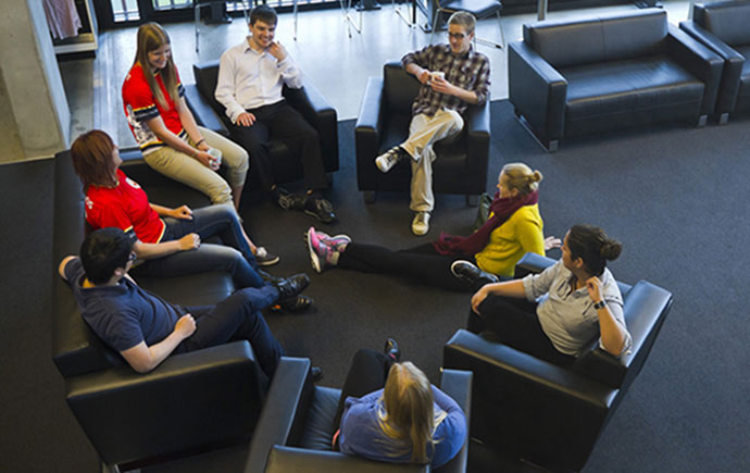Bird eye view of students relaxing on couches