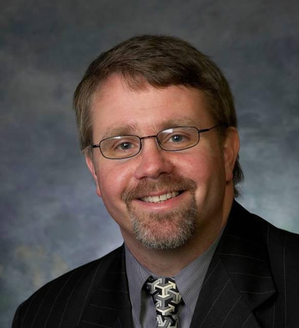 Prof John C Warner