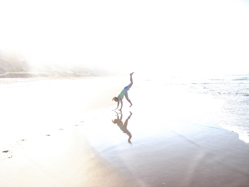 Cartwheeling on the beach, Great Ocean Road