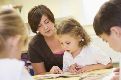Teacher reading with kid_© Monkey Business Images Dreamstime.com