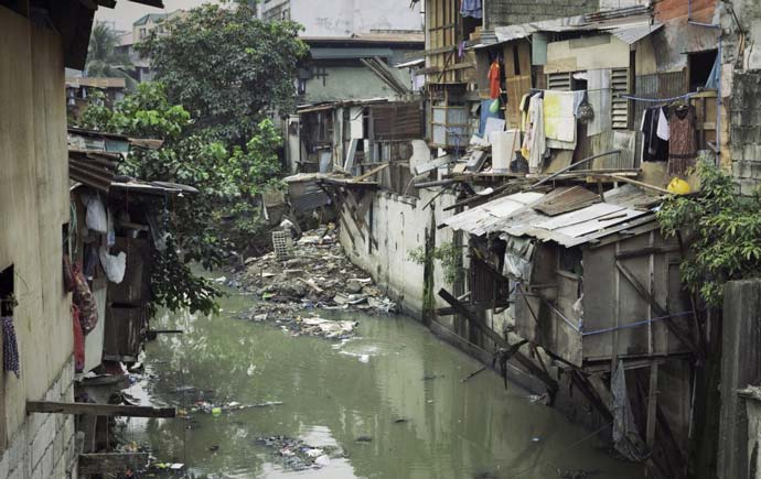Shacks along the water in Manila, Philippines