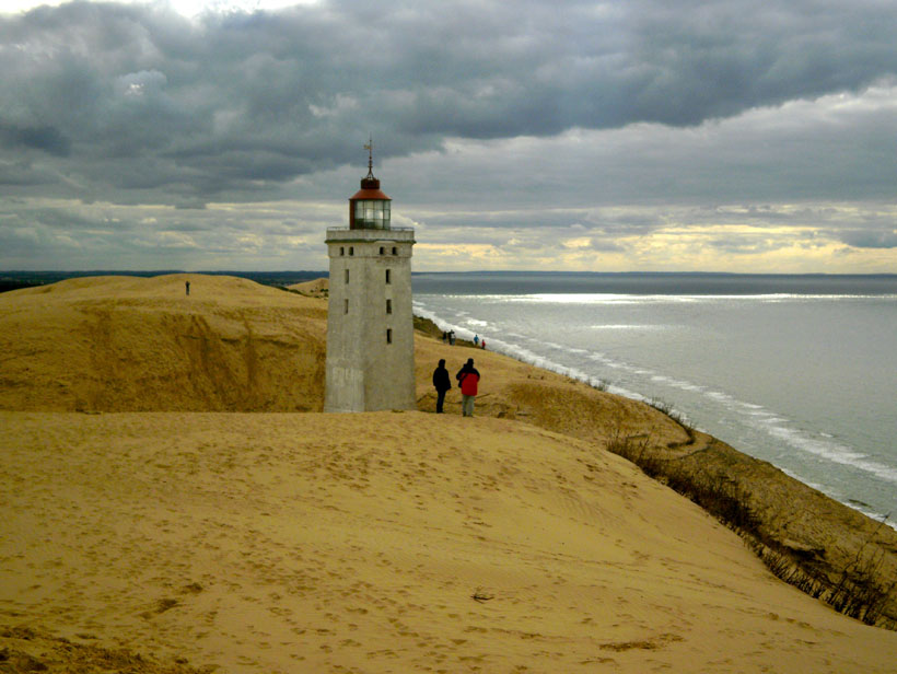 A lighthouse in the sand dunes, Denmark.