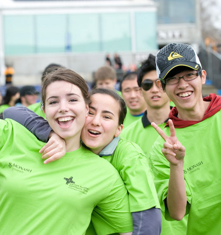 Monash students enjoying open day wearing bright green Monash tee-shirts