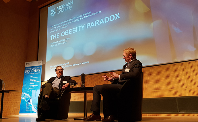 Professor Jeffrey Flier and Professor John Carroll on stage at The Obesity Paradox public lecture.