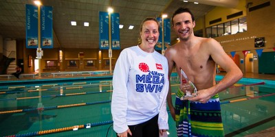 Lisa Beasley, Captain of Dougies Dolphins and MC, presenting Martin de Bono, Captain of the Freestylerz, with trophy for most distance swum