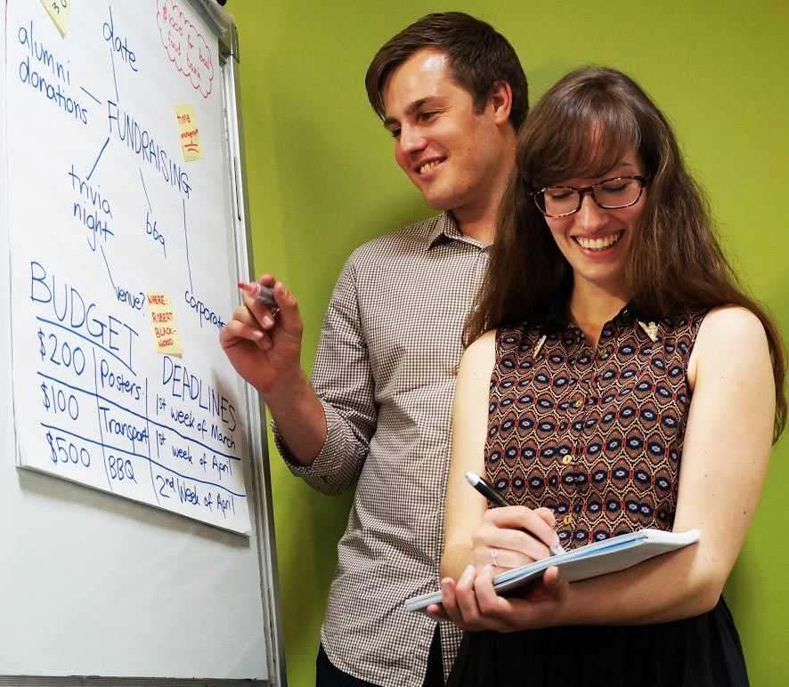 Two Monash students working together on a shared project